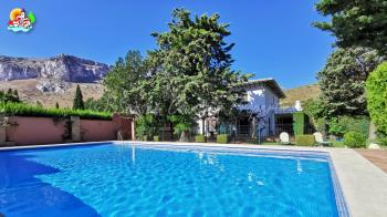 Antequera,  Large detached country property in amazing setting with large swimming pool and private garden with mature trees and plants.